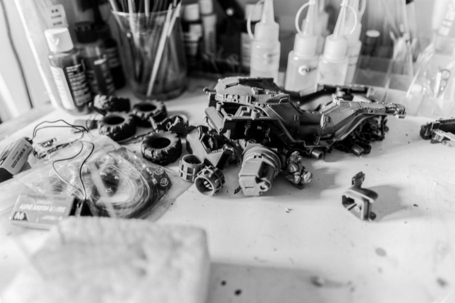 Pieces of an unassembled plastic model in black and white